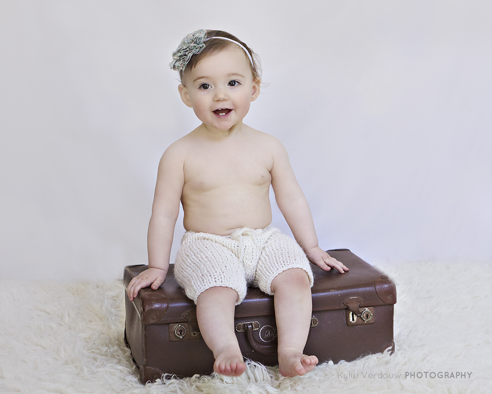 Baby on vintage suitcase