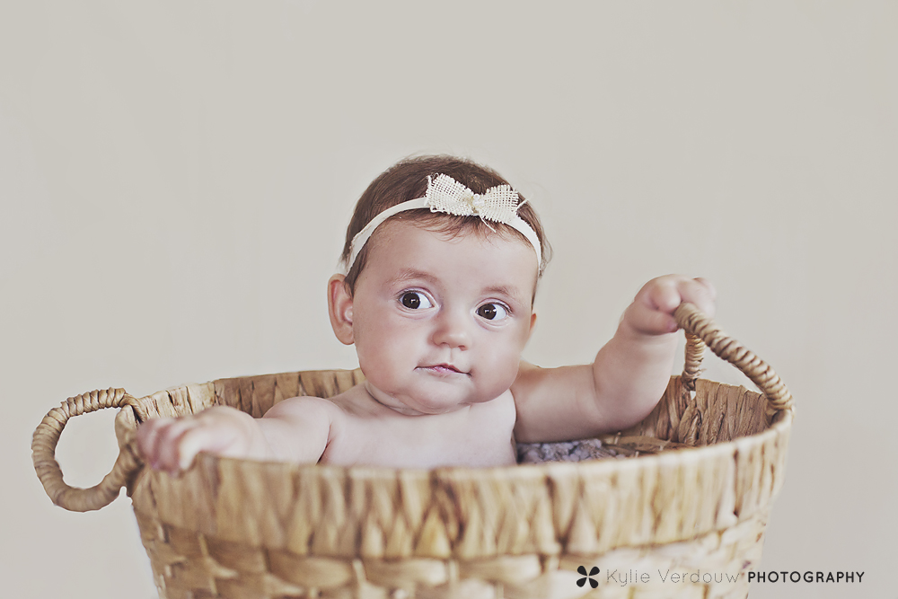 Baby girl in basket with handmade headband