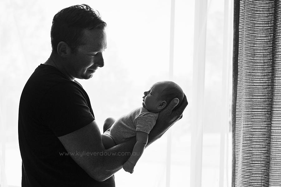 Newborn and dad bond